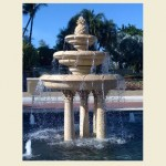 Giant 3 tier fountain in pool with pineapple finial, sitting on 4 pedestals
