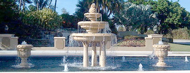 Giant 3 tier fountain on pedestals with pineapple top